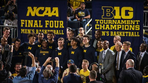 <p>               Michigan head coach John Beilein, third from right, poses for photos with his team and newly unveiled Big Ten Tournament Champions and NCAA Final Four banners, before the first half of an NCAA college basketball game against Norfolk State at Crisler Center in Ann Arbor, Mich., Tuesday, Nov. 6, 2018. (AP Photo/Tony Ding)             </p>