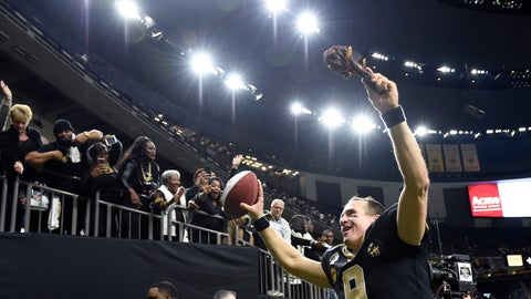 <p>               New Orleans Saints quarterback Drew Brees (9) responds to the fans with a turkey drumstick as he runs off the field Thanksgiving night after an NFL football game against the Atlanta Falcons in New Orleans, Thursday, Nov. 22, 2018. The Saints won 31-17. (AP Photo/Bill Feig)             </p>