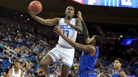 <p>               UCLA guard Kris Wilkes (13) shoots over Presbyterian guard Davon Bell during the first half of an NCAA college basketball game, Monday, Nov. 19, 2018, in Los Angeles. (AP Photo/Michael Owen Baker)             </p>