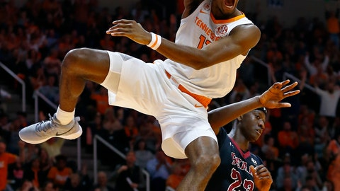 <p>               Tennessee forward Kyle Alexander (11) reacts to dunking the ball over Lenoir-Rhyne forward Emmanuel Wembi (23) during the first half of an NCAA college basketball game Tuesday, Nov. 6, 2018, in Knoxville, Tenn. (AP Photo/Wade Payne)             </p>
