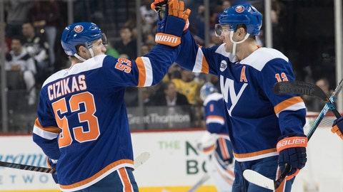 <p>               New York Islanders right wing Josh Bailey (12) celebrates scoring a goal with center Casey Cizikas (53) during the second period of an NHL hockey game against the Pittsburgh Penguins, Thursday, Nov. 1, 2018, in New York. (AP Photo/Mary Altaffer)             </p>