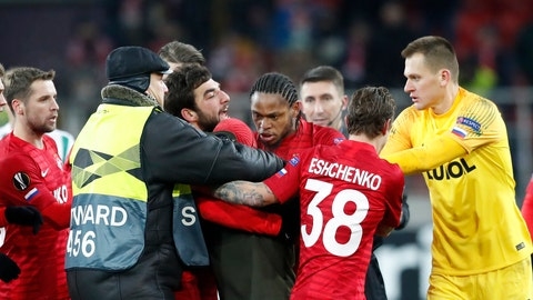 <p>               Spartak's Luiz Adriano, center, discusses with a fan who entered in the field during a Group G Europa League soccer match between Spartak Moscow and Rapid Wien at the Spartak Stadium in Moscow, Russia, Thursday, Nov. 29, 2018. (AP Photo/Pavel Golovkin)             </p>