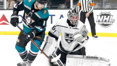 <p>               Los Angeles Kings goalie Jack Campbell (36) makes a save next to Anaheim Ducks forward Adam Henrique (14) during the first period of an NHL hockey game Tuesday, Nov. 6, 2018, in Los Angeles. (AP Photo/Ringo H.W. Chiu)             </p>