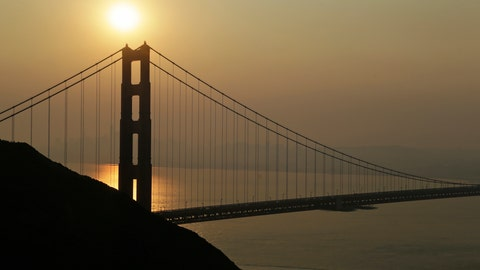 <p>               Smoke from wildfires obscures the San Francisco skyline behind the Golden Gate Bridge Friday, Nov. 9, 2018, near Sausalito, Calif. A California fire official says a blaze in Northern California nearly quadrupled in size overnight. Capt. Scott McLean of the California Department of Forestry and Fire Protection says the fire near the town of Paradise has grown to nearly 110 square miles (285 square kilometers).(AP Photo/Eric Risberg)             </p>