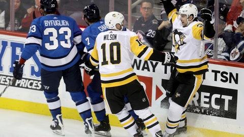 <p>               Pittsburgh Penguins' Garrett Wilson (10) and Derek Grant (38) celebrate after Grant scored on Winnipeg Jets goaltender Connor Hellebuyck (37) during the third period of an NHL hockey game, Tuesday, Nov. 27, 2018, in Winnipeg, Manitoba. (Trevor Hagan/The Canadian Press via AP)             </p>