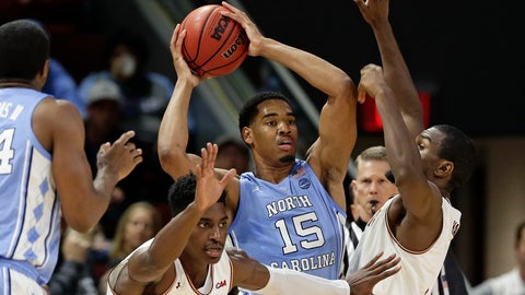 <p>               North Carolina's Garrison Brooks (15) looks to pass while Elon's Kris Wooten, left, and Chuck Hannah guard during the first half of an NCAA college basketball game in Elon, N.C., Friday, Nov. 9, 2018. (AP Photo/Gerry Broome)             </p>