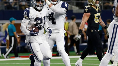 <p>               Dallas Cowboys running back Ezekiel Elliott (21) celebrates his touchdown against the New Orleans Saints with quarterback Dak Prescott (4) in the first half of an NFL football game, in Arlington, Texas, Thursday, Nov. 29, 2018. (AP Photo/Michael Ainsworth)             </p>