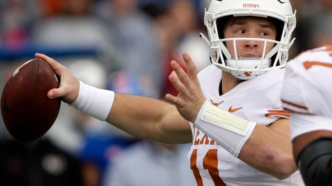 <p>               Texas quarterback Sam Ehlinger (11) passes to a teammate during the first half of an NCAA college football game against Kansas in Lawrence, Kan., Friday, Nov. 23, 2018. (AP Photo/Orlin Wagner)             </p>