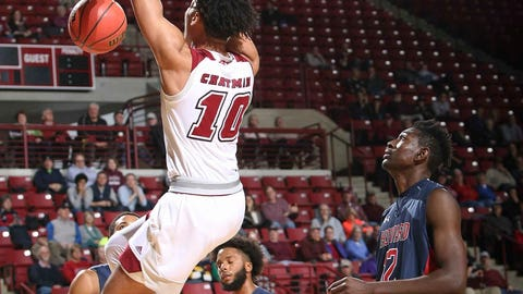 <p>               Massachusetts' Sy Chatman (910) slam-dunks in front of Howard's Akuwovo Ogheneyole in the first half of an NCAA college basketball game in Amherst, Mass., Friday, Nov. 16, 2018. (J. Anthony Roberts/The Republican via AP)             </p>