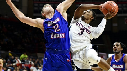 <p>               UConn's Alterique Gilbert (3) goes up against UMass-Lowell's Sesan Russell (2) during the first half of an NCAA college basketball game, Tuesday, Nov. 27, 2018, in Storrs, Conn. (AP Photo/Stephen Dunn)             </p>