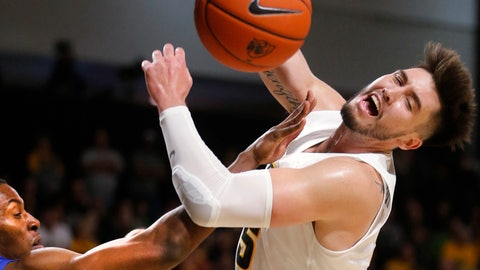 <p>               Virginia Commonwealth's Sean Mobley has the ball knocked away by Hampton's Trevond Barnes during an NCAA college basketball game in Richmond, Va., Friday, Nov. 9, 2018. (Joe Mahoney/Richmond Times-Dispatch via AP)             </p>