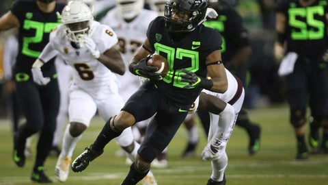 <p>               Oregon's CJ Verdell, center, breaks through the Arizona State defense during the second quarter of an NCAA college football game Saturday, Nov. 17, 2018, in Eugene, Ore. (AP Photo/Chris Pietsch)             </p>