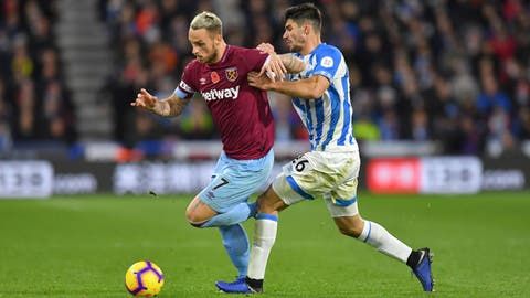 <p>               West Ham United's Marko Arnautovic, left, and Huddersfield Town's Christopher Schindler battle for the ball during the English Premier League soccer match between Huddersfield Town and West Ham United at the John Smith's Stadium, Huddersfield, England. Saturday Nov. 10 2018. (Dave Howarth/PA via AP)             </p>