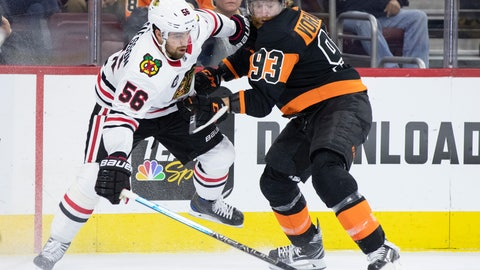 <p>               Chicago Blackhawks' Erik Gustafsson, left, of Sweden, and Philadelphia Flyers' Jakub Voracek, right, of the Czech Republic, battle for the puck during the second period of an NHL hockey game, Saturday, Nov. 10, 2018, in Philadelphia. (AP Photo/Chris Szagola)             </p>