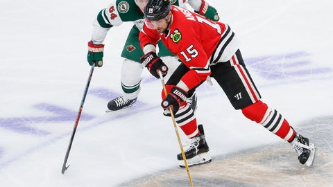 <p>               Chicago Blackhawks center Artem Anisimov (15) battles for the puck with Minnesota Wild right wing Mikael Granlund (64) during the third period of an NHL hockey game Sunday, Nov. 18, 2018, in Chicago. (AP Photo/Kamil Krzaczynski)             </p>
