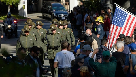 <p>               The body of Ventura County Sheriff's Department Sgt. Ron Helus is transported from the Los Robles Regional Medical Center Thursday, Nov. 8, 2018, in Thousand Oaks, Calif., after a gunman opened fire Wednesday inside a country music bar killing multiple people including Helus. (AP Photo/Mark J. Terrill)             </p>