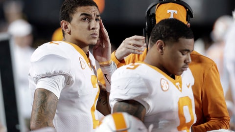 <p>               Tennessee quarterback Jarrett Guarantano, left, looks at the scoreboard late in the fourth quarter of an NCAA college football game against Vanderbilt, Saturday, Nov. 24, 2018, in Nashville, Tenn. (AP Photo/Mark Humphrey)             </p>
