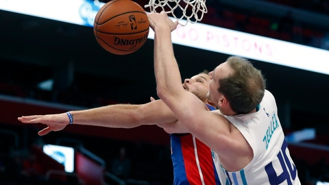 <p>               Detroit Pistons forward Blake Griffin and Charlotte Hornets center Cody Zeller (40) reach for the rebound during the first half of an NBA basketball game, Sunday, Nov. 11, 2018, in Detroit. (AP Photo/Carlos Osorio)             </p>