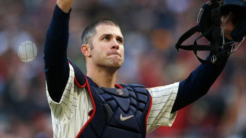 <p>               FILE - In this Sunday, Sept. 30, 2018, file photo, Minnesota Twins' Joe Mauer acknowledges a standing ovation as he donned catcher's gear and caught for one pitch against a Chicago White Sox batter in the ninth inning of a baseball game  in Minneapolis. Mauer began his career as a catcher before switching to first base. The Minneapolis Star Tribune reports that Mauer has taken out an ad in its Sunday, Nov. 11, 2018, paper to announce his retirement. (AP Photo/Jim Mone, File)             </p>