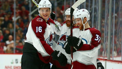 <p>               Colorado Avalanche left wing J.T. Compher (37) celebrates his short-handed goal against the Arizona Coyotes with Avalanche defenseman Nikita Zadorov (16) and defenseman Ian Cole, center, during the first period of an NHL hockey game Friday, Nov. 23, 2018, in Glendale, Ariz. (AP Photo/Ross D. Franklin)             </p>