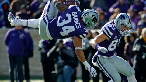 <p>               Kansas State running back Alex Barnes (34) leaps over Kansas safety Mike Lee (11) as he runs for a first down during the first half of an NCAA college football game Saturday, Nov. 10, 2018, in Manhattan, Kan. (AP Photo/Charlie Riedel)             </p>