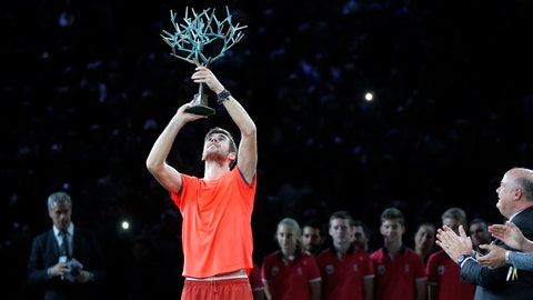 <p>               Karen Khachanov of Russia raises the trophy after defeating Novak Djokovic of Serbia in their final match of the Paris Masters tennis tournament at the Bercy Arena in Paris, France, Sunday, Nov. 4, 2018. (AP Photo/Michel Euler)             </p>