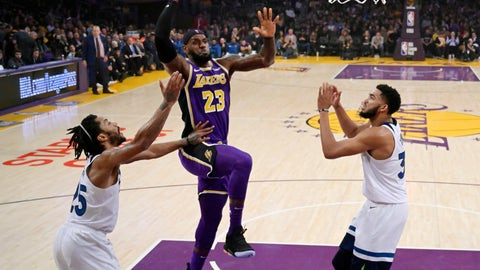 <p>               Los Angeles Lakers forward LeBron James, center, shoots as Minnesota Timberwolves guard Derrick Rose, left, and center Karl-Anthony Towns defend during the first half of an NBA basketball game Wednesday, Nov. 7, 2018, in Los Angeles. (AP Photo/Mark J. Terrill)             </p>