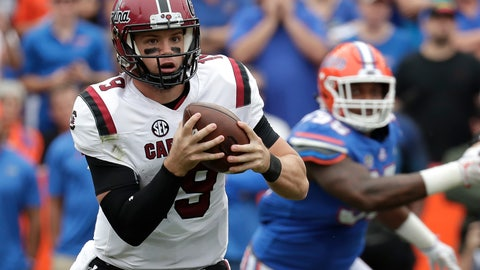 <p>               South Carolina quarterback Jake Bentley, left, scrambles as he is pressured by the Florida defense during the first half of an NCAA college football game, Saturday, Nov. 10, 2018, in Gainesville, Fla. (AP Photo/John Raoux)             </p>