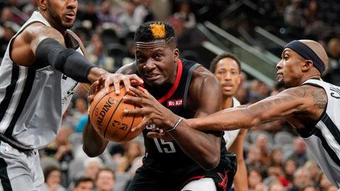 <p>               Houston Rockets' Clint Capela (15) drives between San Antonio Spurs' LaMarcus Aldridge, left, and Dante Cunningham during the first half of an NBA basketball game Friday, Nov. 30, 2018, in San Antonio. (AP Photo/Darren Abate)             </p>