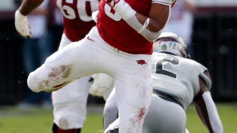 <p>               Arkansas running back Rakeem Boyd (5) hurdles a Mississippi State player on his way to a first down during the first half of an NCAA college football game in Starkville, Miss., Saturday, Nov. 17, 2018. Mississippi State won 52-6. (AP Photo/Rogelio V. Solis)             </p>