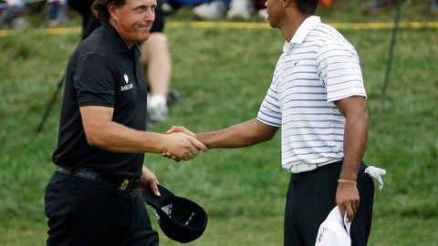 <p>               FILE - In this Aug. 8, 2014, file photo, Phil Mickelson, left, shakes hands with Tiger Wood after the second round of the PGA Championship golf tournament at Valhalla Golf Club in Louisville, Ky. Woods and Mickelson play pay-per-view exhibition Friday in Las Vegas. (AP Photo/David J. Phillip, File)             </p>