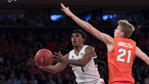 <p>               Connecticut guard Christian Vital (1) goes to the basket against Syracuse forward Marek Dolezaj (21) during the second half of an NCAA college basketball game in the 2K Empire Classic, Thursday, Nov. 15, 2018, at Madison Square Garden in New York. Connecticut won 83-76. (AP Photo/Mary Altaffer)             </p>