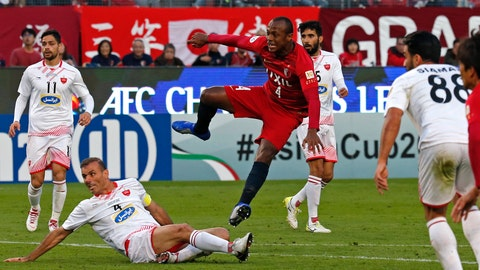 <p>               Kashima Antlers Leo Silva, center, scores his team's first goal against Persepolis FC during the first leg of the Asian Champions League finals in Kashima, near Tokyo, Saturday, Nov. 3, 2018.(AP Photo/Shuji Kajiyama)             </p>