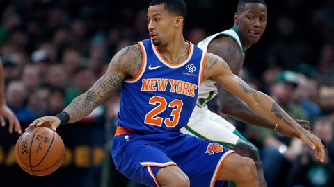 <p>               New York Knicks' Trey Burke (23) makes a move against Boston Celtics' Terry Rozier, right, during the first half on an NBA basketball game in Boston, Wednesday, Nov. 21, 2018. (AP Photo/Michael Dwyer)             </p>