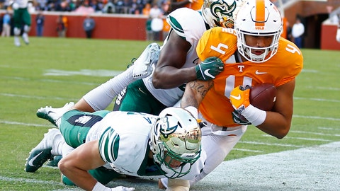 <p>               Tennessee tight end Dominick Wood-Anderson (4) is knocked out of bounds by Charlotte defensive back Ben DeLuca (28) and a teammate in the first half of an NCAA college football game Saturday, Nov. 3, 2018, in Knoxville, Tenn. (AP Photo/Wade Payne)             </p>