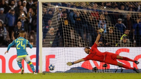<p>               Napoli's Lorenzo Insigne beats PSG goalkeeper Gianluigi Buffon to score his team's first goal on a penalty kick during a Champions League, group C soccer match between Napoli and Paris Saint Germain, at the San Paolo stadium in Naples, Italy, Tuesday, Nov. 6, 2018. (AP Photo/Andrew Medichini)             </p>