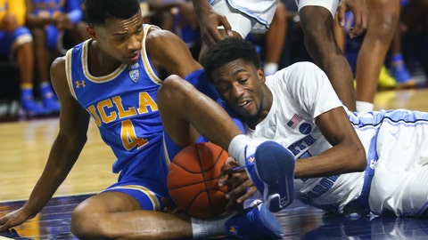 <p>               UCLA's Jaylen Hands, left, battles for a loose ball against North Carolina's Brandon Robinson during the second half of an NCAA college basketball game Friday, Nov. 23, 2018, in Las Vegas. (AP Photo/Chase Stevens)             </p>