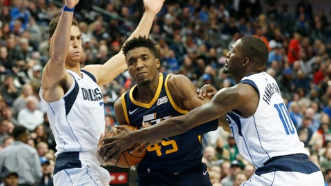 <p>               Dallas Mavericks forward Dwight Powell (7) and forward Dorian Finney-Smith (10) defend Utah Jazz guard Donovan Mitchell (45) during the second half of an NBA basketball game in Dallas, Wednesday, Nov. 14, 2018. Dallas won 118-68. (AP Photo/Michael Ainsworth)             </p>