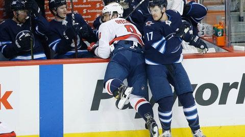 <p>               Winnipeg Jets' Adam Lowry (17) checks Washington Capitals' Alex Ovechkin (8) during first period NHL hockey action in Winnipeg, Manitoba on Wednesday, Nov. 14, 2018. (John Woods/The Canadian Press via AP)             </p>