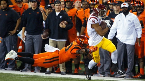 <p>               Southern California's Amon-Ra St. Brown (8) pulls away from Oregon State's Jalen Moore, left, after making a reception in the first half of an NCAA college football game in Corvallis, Ore., Saturday, Nov. 3, 2018. (AP Photo/Timothy J. Gonzalez)             </p>