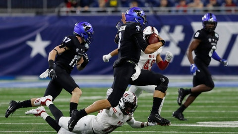 <p>               Buffalo quarterback Tyree Jackson (3) scrambles during the first half of the Mid-American Conference championship NCAA college football game against Northern Illinois, Friday, Nov. 30, 2018, in Detroit. (AP Photo/Carlos Osorio)             </p>