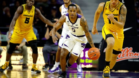Kansas State's Barry Brown Jr. (5) drives with the ball during the first half of an NCAA college basketball game against Kennesaw State on Friday, Nov. 9, 2018, in Manhattan, Kan. (AP Photo/Charlie Riedel)
