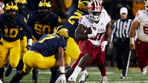 Nov 17, 2018; Ann Arbor, MI, USA; Indiana Hoosiers running back Stevie Scott (21) rushes at Michigan Wolverines linebacker Khaleke Hudson (7) in the second half at Michigan Stadium. Mandatory Credit: Rick Osentoski-USA TODAY Sports