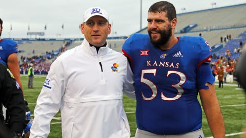 Nov 23, 2018; Lawrence, KS, USA; Kansas Jayhawks head coach David Beaty leaves the field with offensive lineman Alex Fontana (53) after the game against the Texas Longhorns at Memorial Stadium. Mandatory Credit: Jay Biggerstaff-USA TODAY Sports