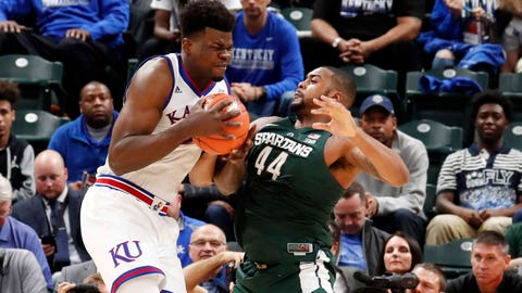 Nov 6, 2018; Indianapolis, IN, USA; Kansas Jayhawks center Udoka Azubuike (35) is guarded by Michigan State Spartans forward Nick Ward (44) in the second half during the Champions Classic at Bankers Life Fieldhouse. Mandatory Credit: Brian Spurlock-USA TODAY Sports