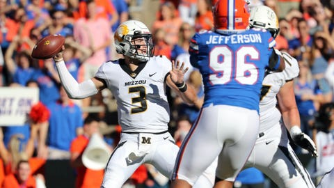 Missouri Tigers quarterback Drew Lock (3) looks to pass the ball as Florida Gators defensive lineman Cece Jefferson (96) rushes during the first quarter at Ben Hill Griffin Stadium. Mandatory Credit: Kim Klement-USA TODAY Sports