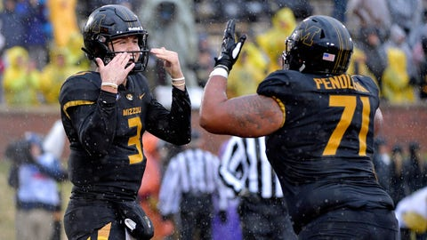 Nov 23, 2018; Columbia, MO, USA; Missouri Tigers quarterback Drew Lock (3) celebrates with offensive lineman Kevin Pendleton (71) after scoring during the first half against the Arkansas Razorbacks at Memorial Stadium/Faurot Field. Mandatory Credit: Denny Medley-USA TODAY Sports
