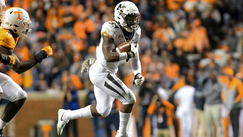 Nov 17, 2018; Knoxville, TN, USA; Missouri Tigers running back Larry Rountree III (34) runs with the ball against the Tennessee Volunteers during the second half at Neyland Stadium. Missouri won 50 to 17. Mandatory Credit: Randy Sartin-USA TODAY Sports
