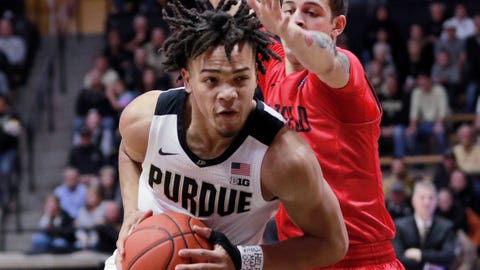 Purdue guard Carsen Edwards, left, moves toward the basket defended by Fairfield guard Neftali Alvarez during an NCAA college basketball game, Tuesday, Nov. 6, 2018, in West Lafayette, Ind. (AP Photo/R Brent Smith)