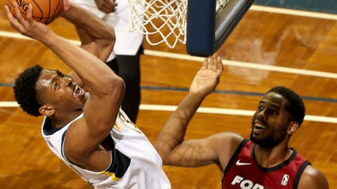 SIOUX FALLS, SD - NOVEMBER 2: Ike Anigbogu #13 from the Fort Wayne Mad Ants lays the ball up for two points past Yante Maten #10 of the Sioux Falls Skyforce during an NBA G-League game on November 2, 2018 at the Sanford Pentagon in Sioux Falls, South Dakota. NOTE TO USER: User expressly acknowledges and agrees that, by downloading and or using this photograph, User is consenting to the terms and conditions of the Getty Images License Agreement. Mandatory Copyright Notice: Copyright 2018 NBAE (Photo by Dave Eggen/NBAE via Getty Images)